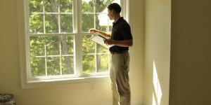 Man checking on energy efficiency of windows